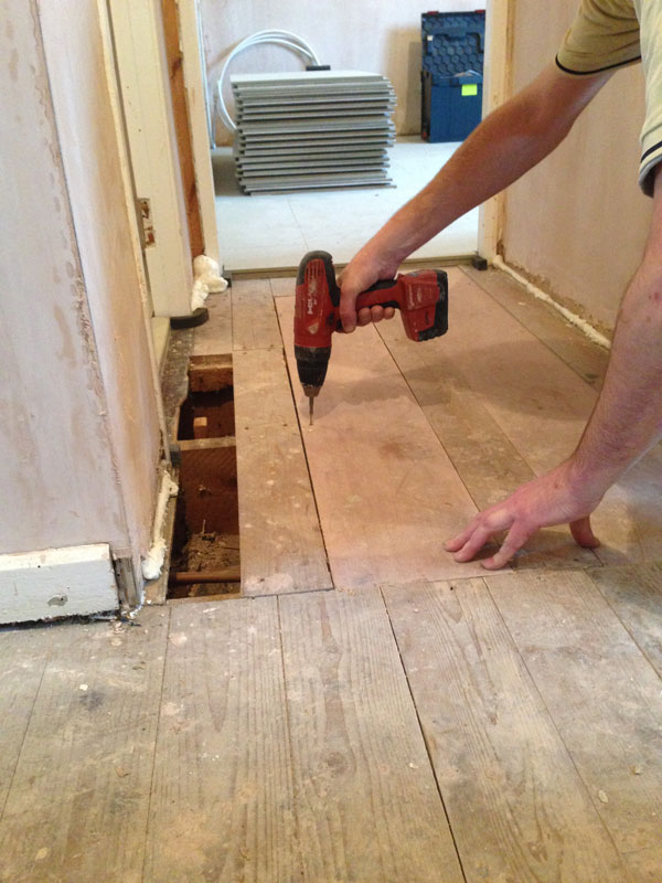 Stage 3: Screwing down replacement floorboards