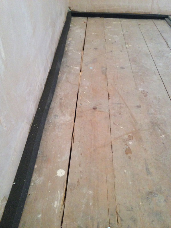 Stage 4: Perimeter tape installed ready for acoustic sealant onto floorboard