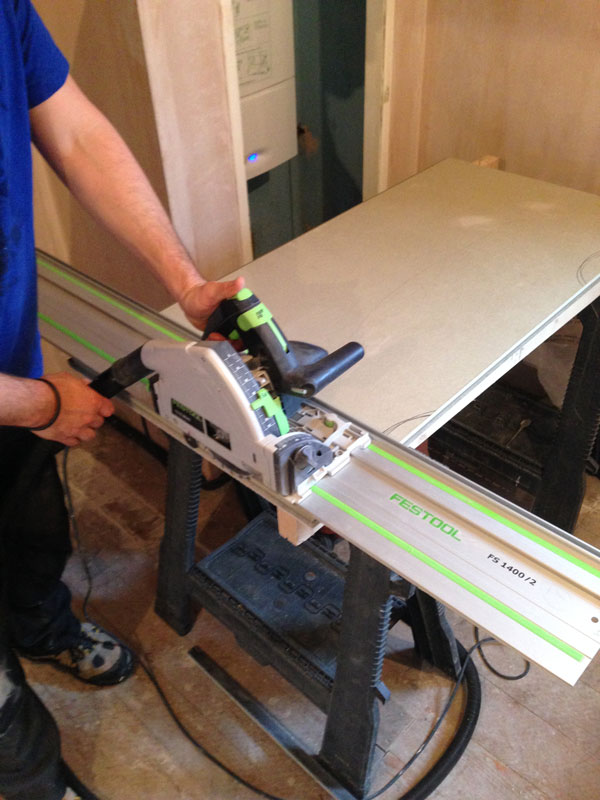 Stage 6: Cutting acoustic flooring with dust extraction