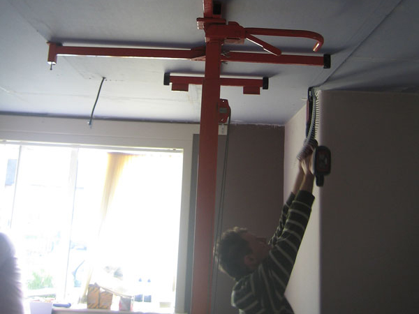 Stage 9: Lifter holding acoustic sheet in position